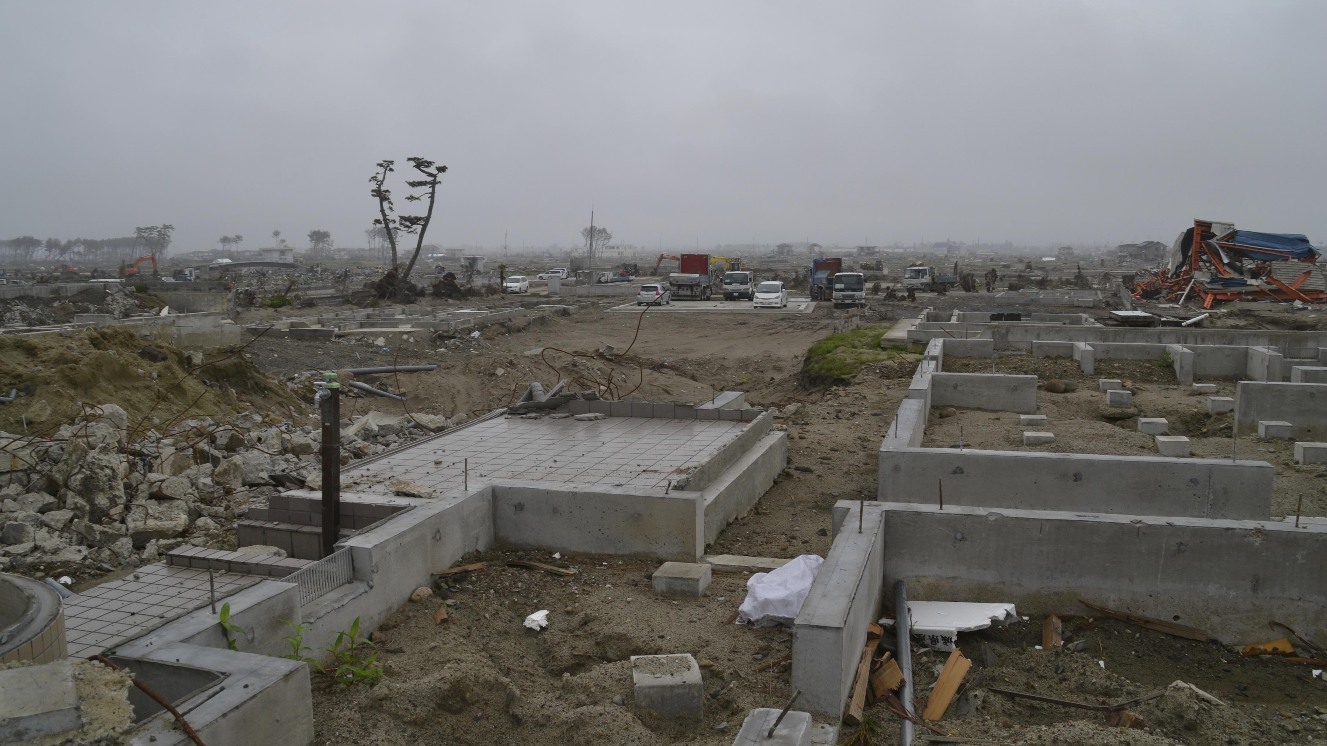 arahama flattened house foundation foreground machines work.JPG