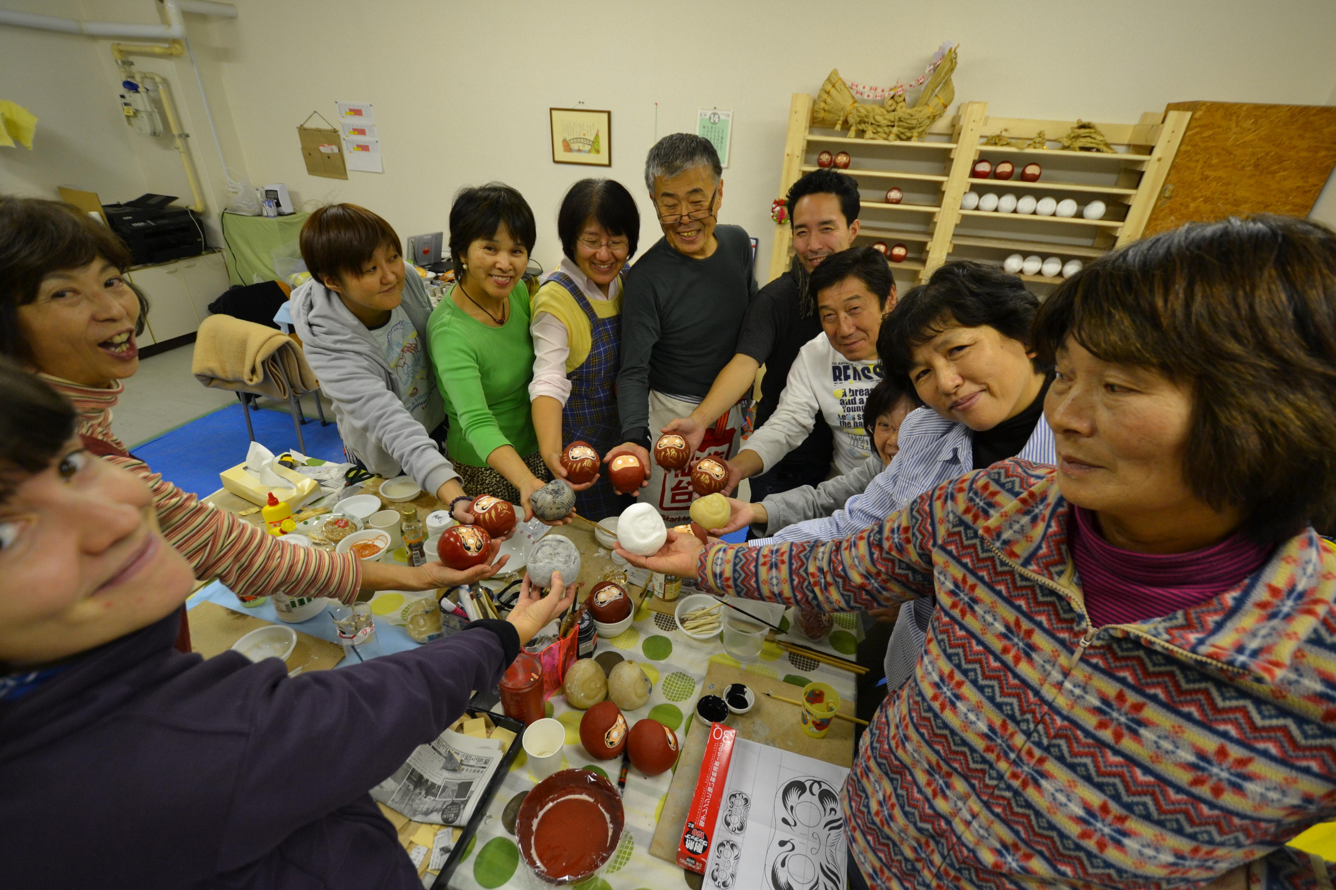 sendai daruma group and hands circle.JPG