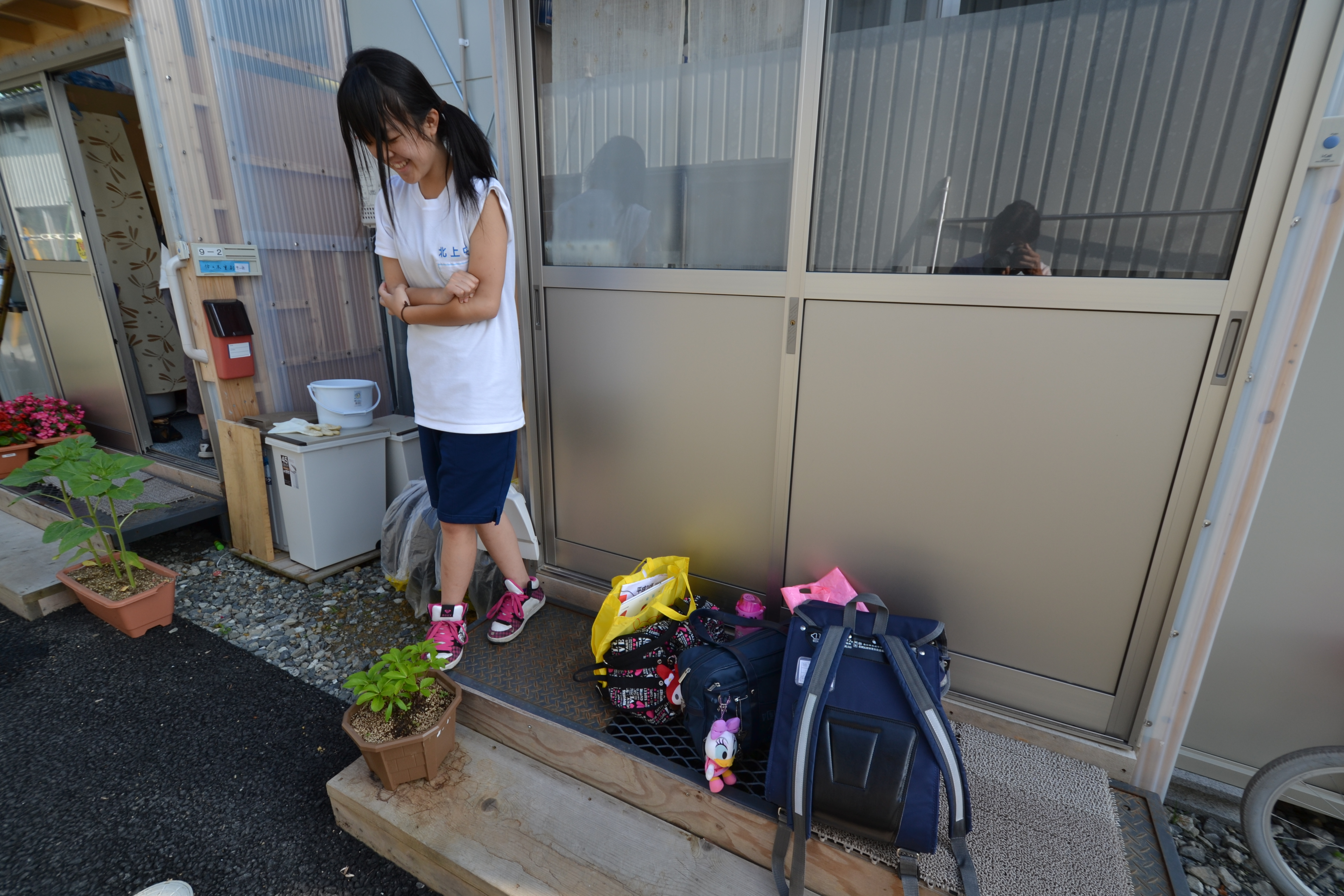 naburi nearby a student comes home to temp housing kasetsu complex .JPG