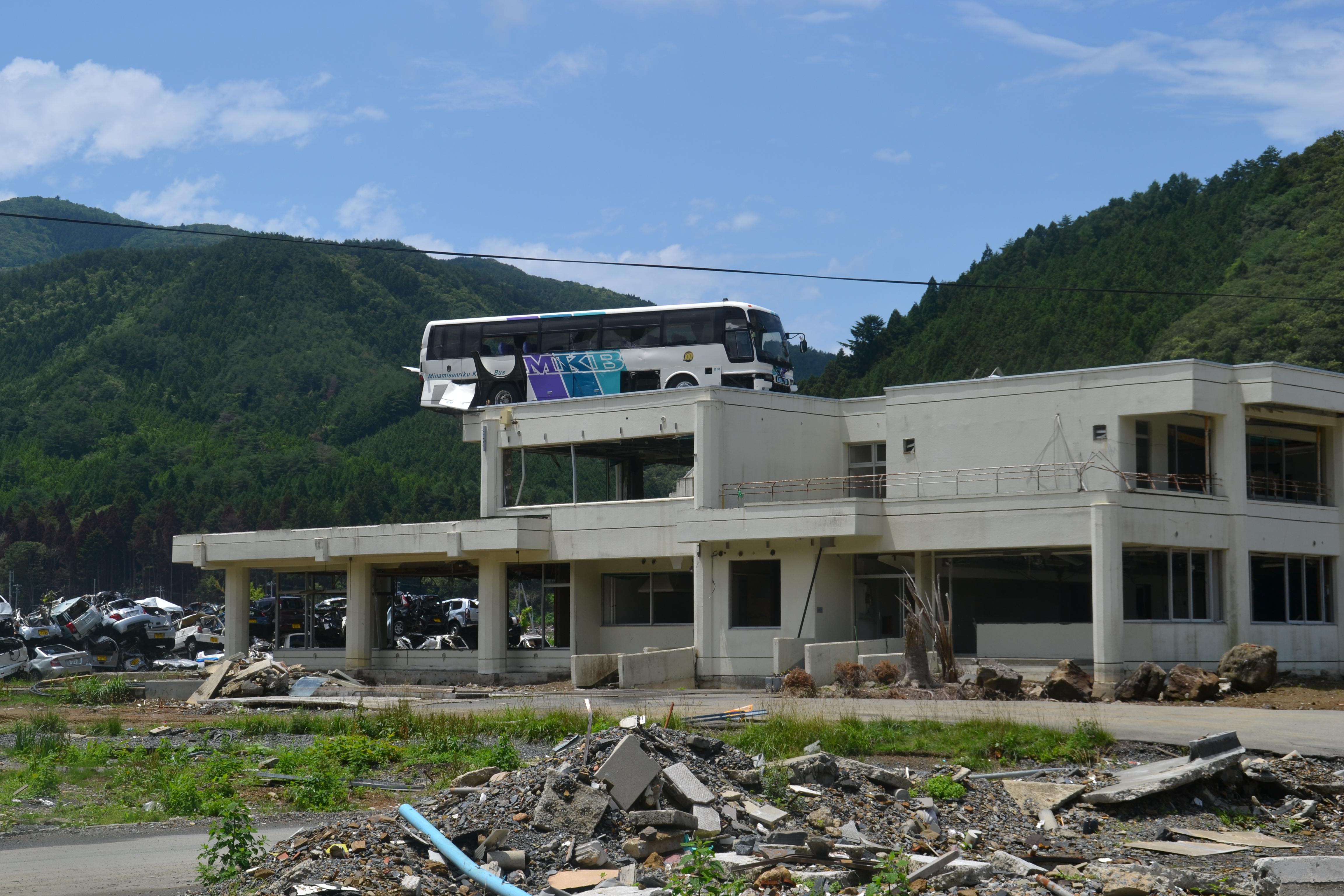 onagawa bus on top of building.JPG