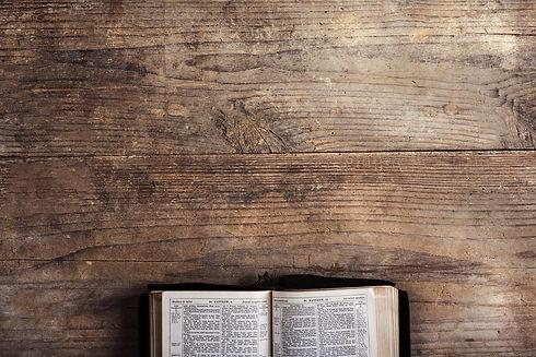 bible-on-a-wooden-desk-PBEE7YJ.jpg