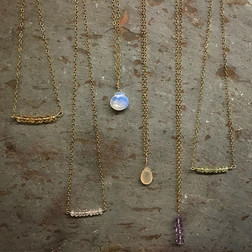 Om-made gold layering bars and drops.