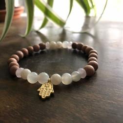 18 Rose wood, 9 moonstone and 4 rose quartz beads.