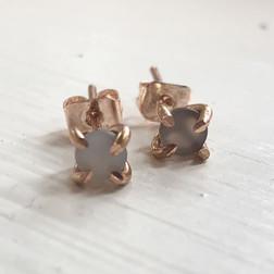 Never underestimate the elegance of a simple pair of stud earrings.