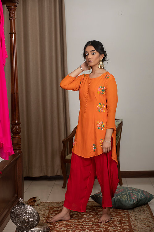 Orange phool kurta & Red dhoti pants