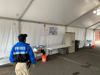 Banner of Decontamination Station in tent