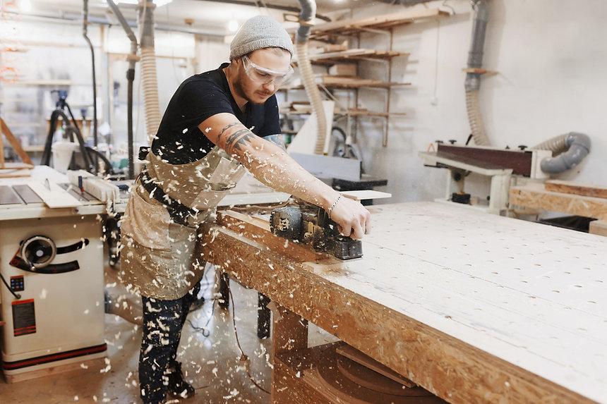 Carpenter making custom office furniture