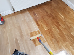 Oak floor being lacquered