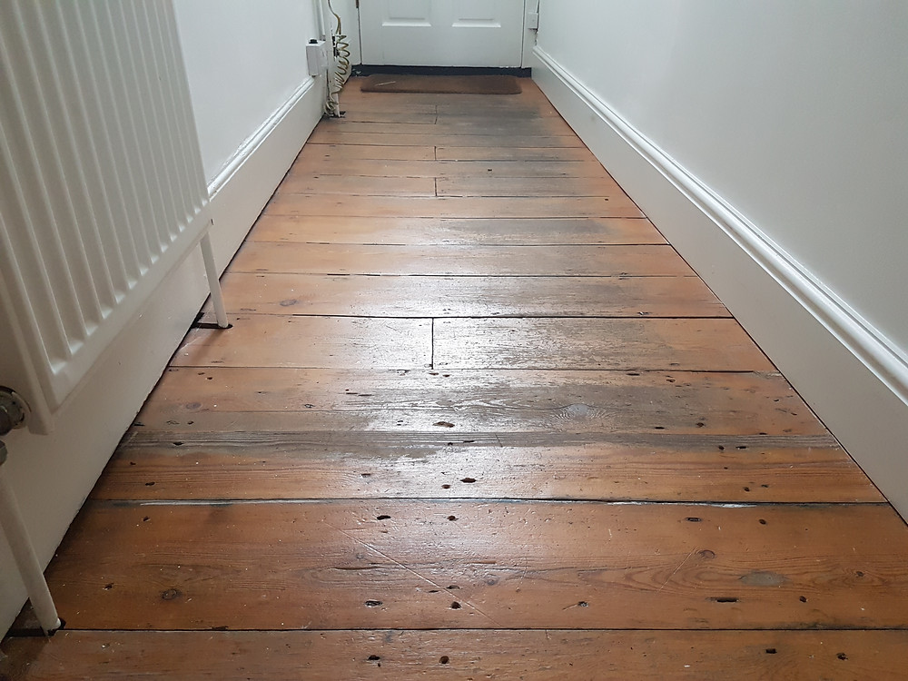Worn pine floor in Cambridge timeless Floor Restorations