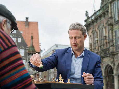 Advertising Photography by Alasdair Jardine. Marco Bode playing chess, Marktplatz Bremen.
