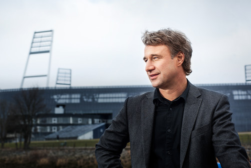 Marco Bode in front of the Weserstadion. Advertising photography by Alasdair Jardine