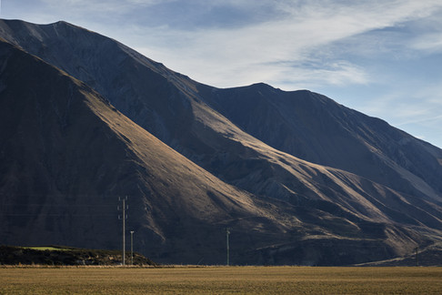 Landscape Photography by Alasdair Jardine. Late afternoon light on the hills beside Lake Coleridge, Canterbury high country, New Zealand.