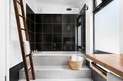 Bathtub and Shower - UNWIND Cottage