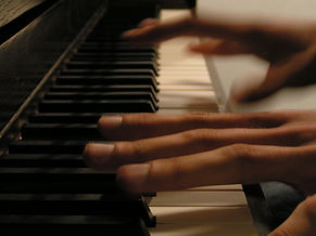 Adult hands playing piano