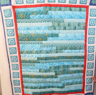 Teal Jelly Roll & Medallions Quilt