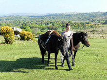 Robyn Petrie-Ritchie with Petal and May - two Dartmoor Pack Ponies from Diana and Crispin Alford's Cawsand Herd on north Dartmoor.