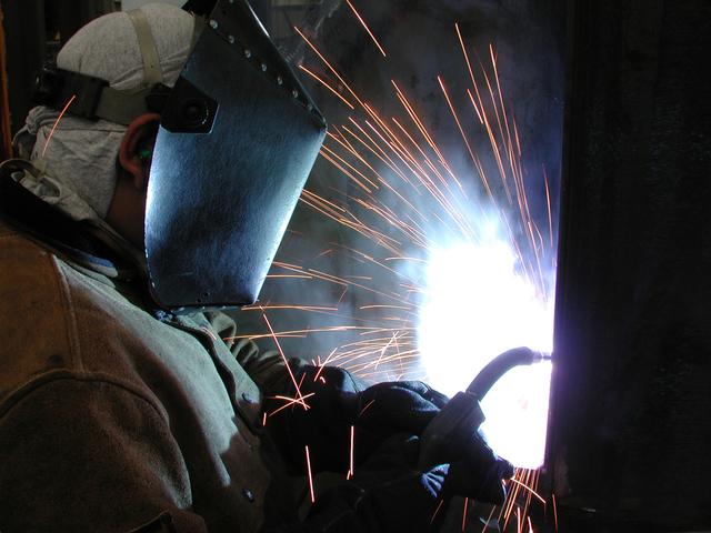 man welding manufacturing