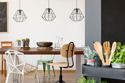 Room-with-communal-table-chairs-pendant-