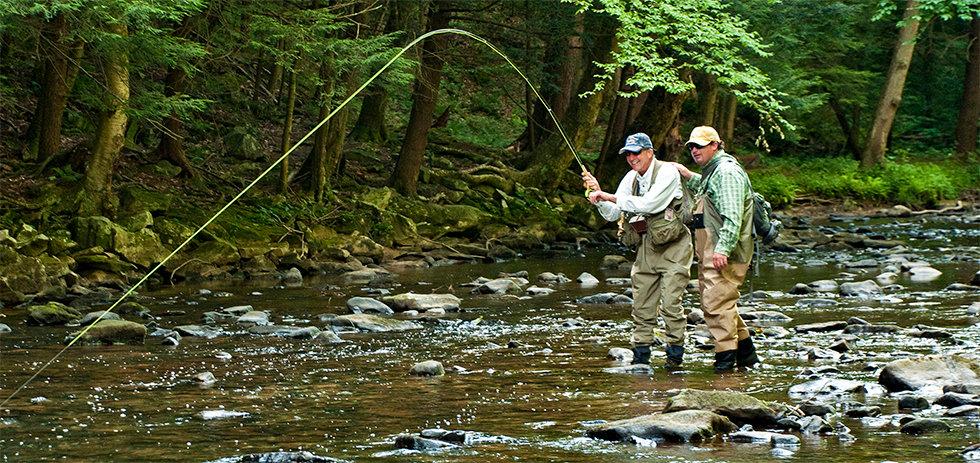 Men Fly Fishing in the Casselman River (Laurel Highlands Visitors Bureau)