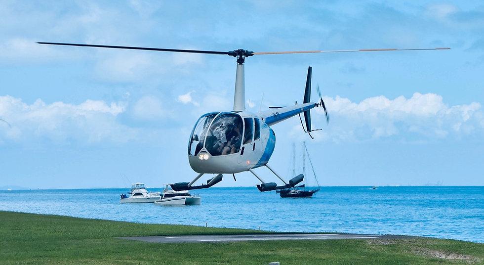 white%20helicopter%20on%20grassy%20cliff_edited.jpg