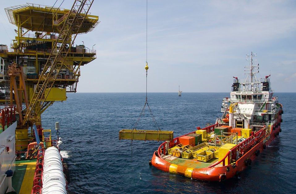 Cargo being loaded from a offshore platform onto a supply vessel.jpg