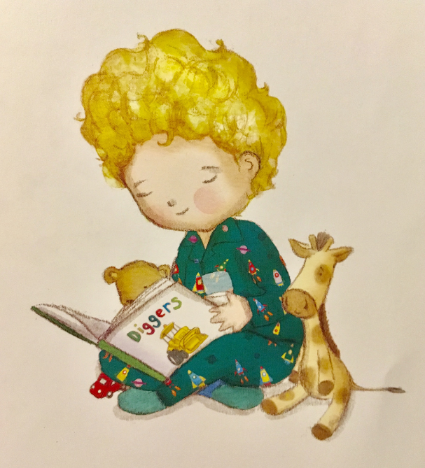 Oliver reading a digger book with a glass of milk in his hand
