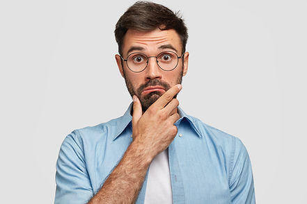 photo-of-surprised-bearded-male-holds-chin-and-looks-in-hesitation-wonders-latest-news-wea