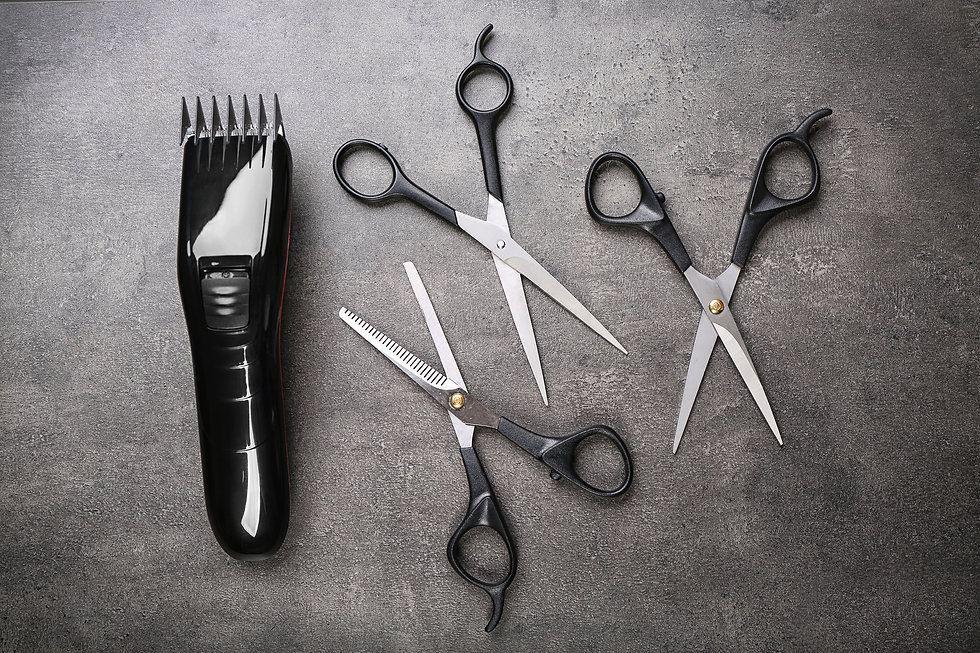 Barber set with hair trimmer and scissors on grey background.jpg