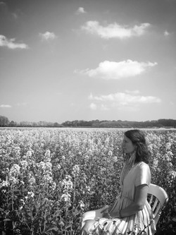 Seated in a field of yellow