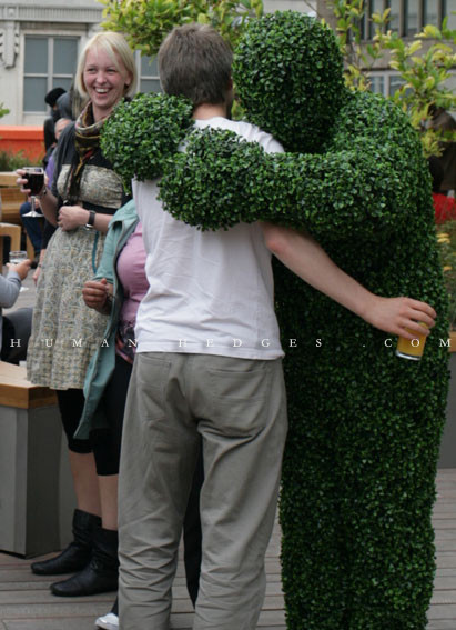 Living Topiary Hugs Man