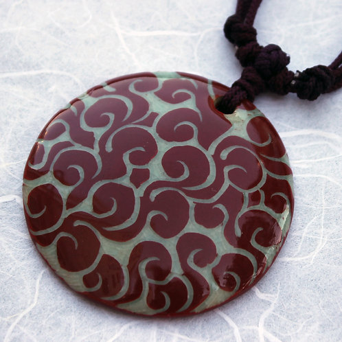 Celadon Pendant with Red Swirls