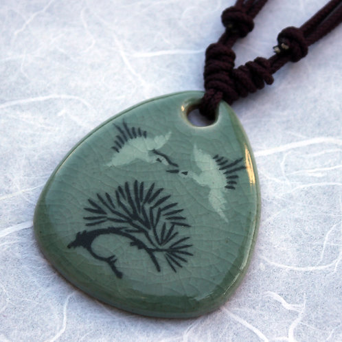 Celadon Pendant with Two Cranes over a Tree