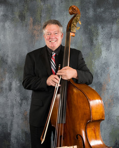 Steve with suit and bass 5.15.jpg