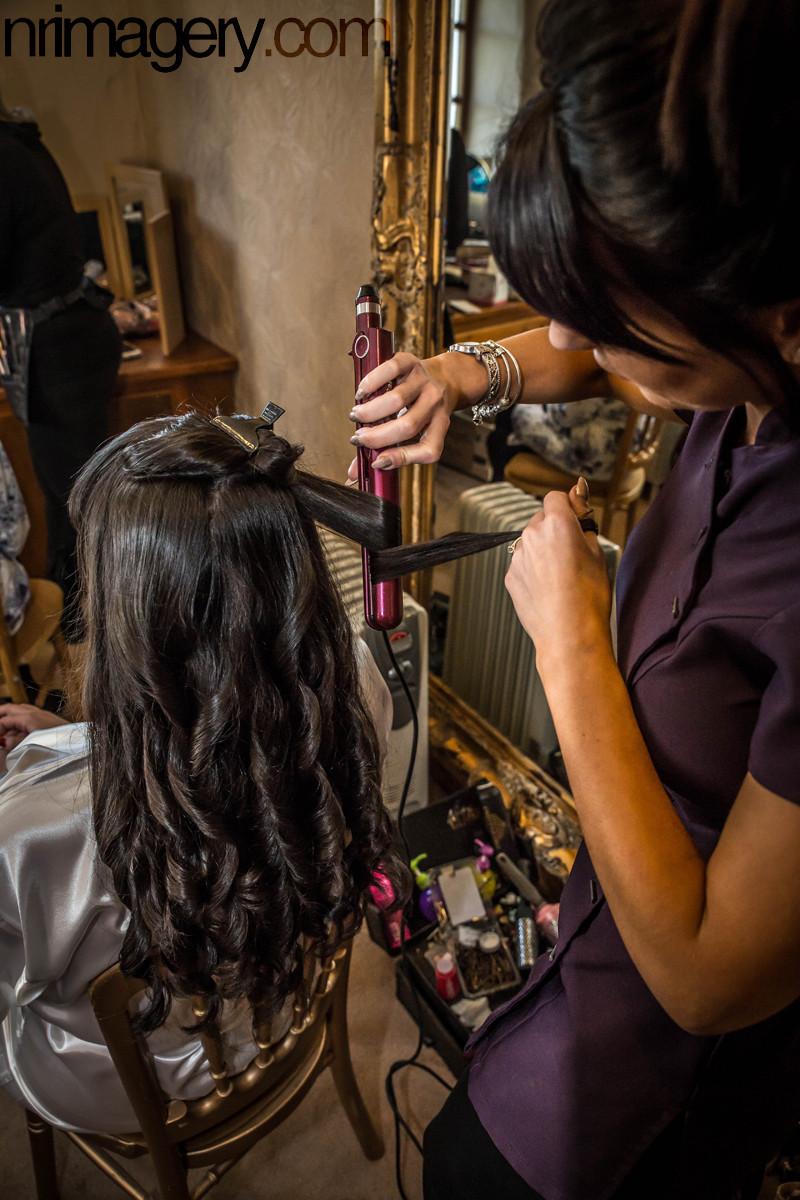 Hairdresser at the venue. Photographed with a Canon EOS 5D Mk III & Tamron SP 24-70mm f2.8 lens - ISO-2500, f/5, 1/400