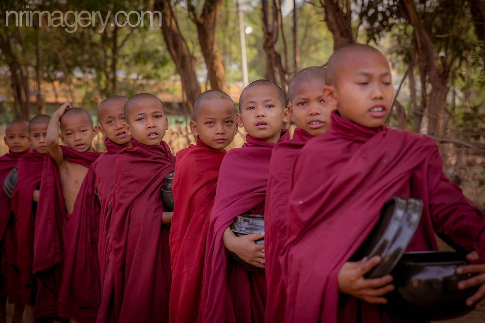 Young Monks collecting their morning 'Alms'. Photographed with Canon EOS 6D with Tamron SP 24-70mm f/2.8 - ISO-800, f/4, 1/500