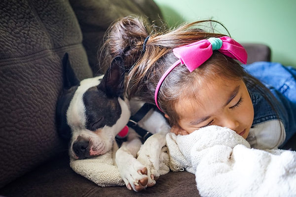 Girl sleeping with dog.jpg