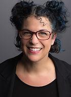 Wendy-Marie Headshot glasses smile.jpg