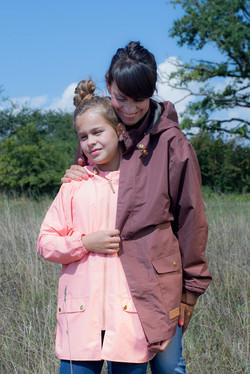 pink coat, brown coat