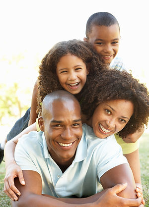 Portrait of Happy Family Piled Up In Par