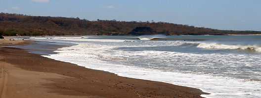 Playa Astillero, Nicaragua beach break with surfers