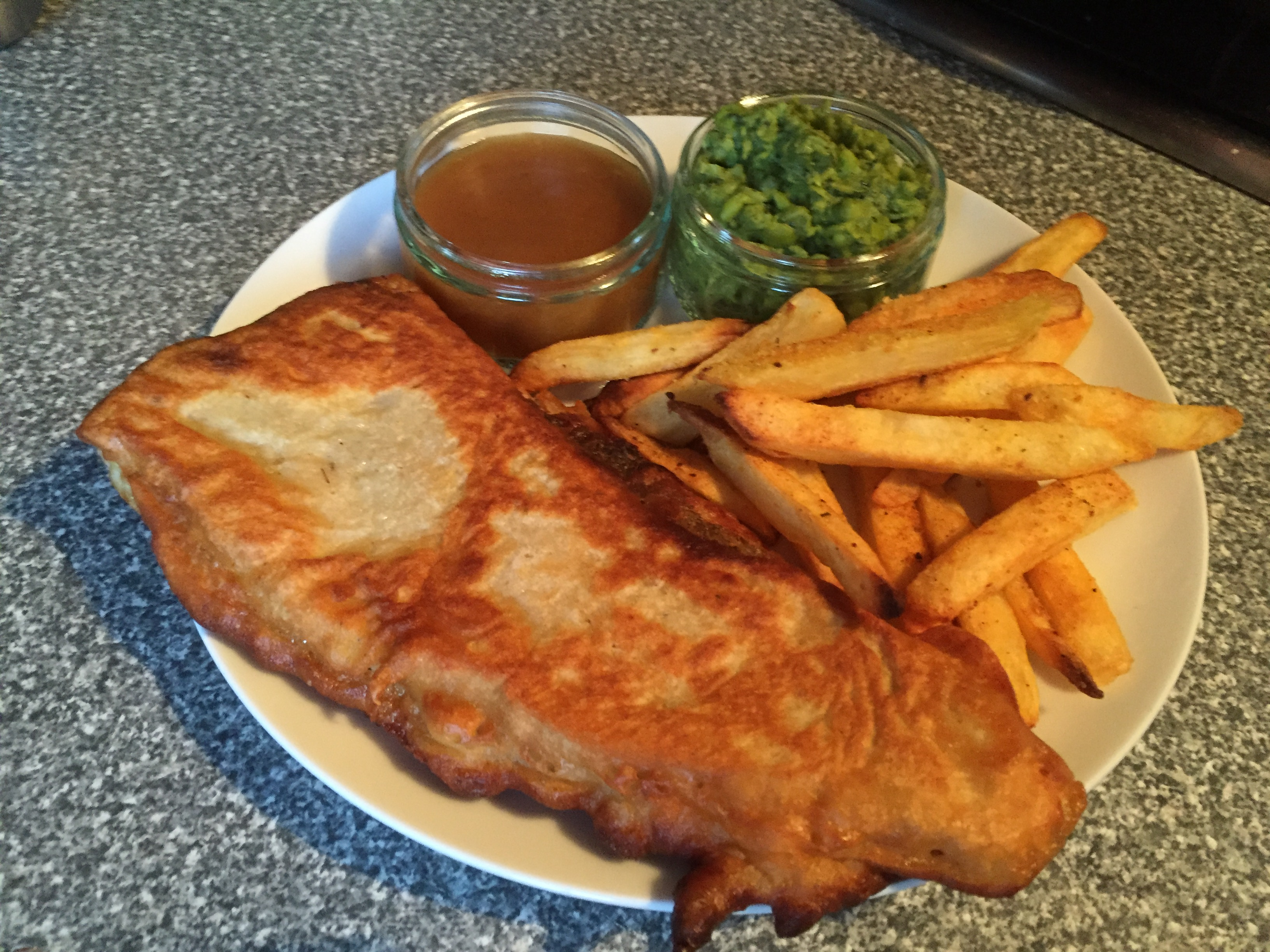 Cod pancake, chips, mushy peas