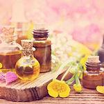 Essential oil bottles on medicinal flowe