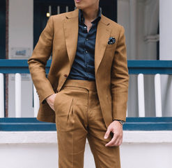 The V pleated trousers on a Tobacco Suit