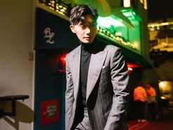 Wide Peak Lapel in a Gray Chalk Stripe Three Piece Suit