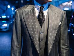 Wide Peak Lapel in a Three Piece Pin Stripe Suit