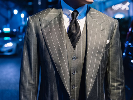 Wide Peak Lapel in a Three Piece Pin Stripe Suit