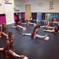 Jazz II dancers using the blocks to add height to their front leg