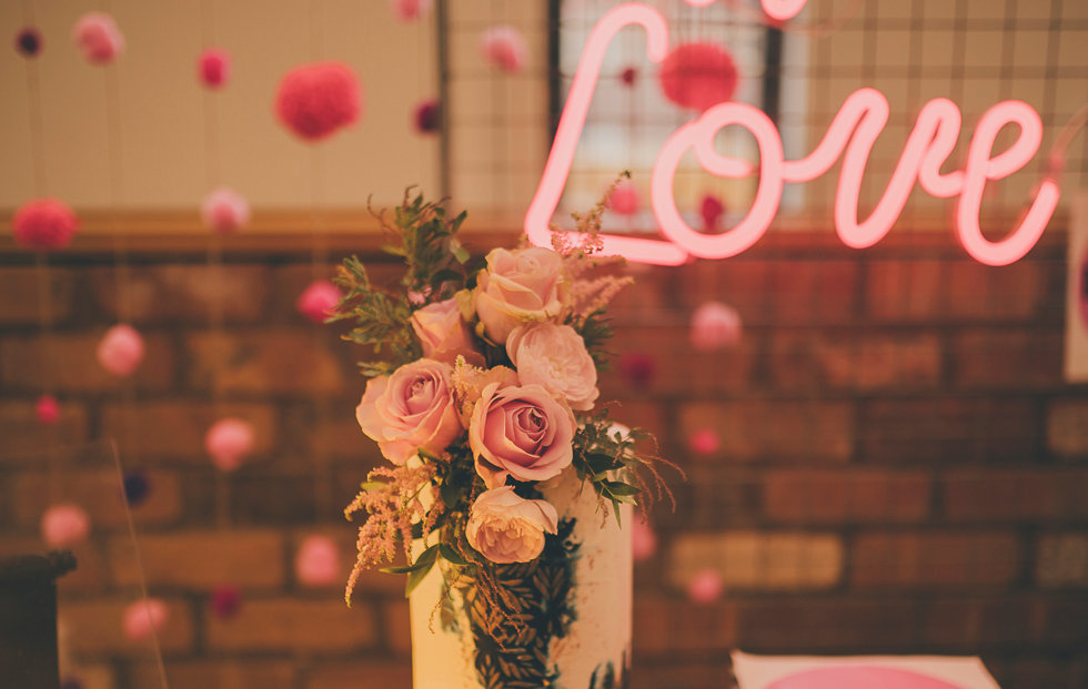 Neon and Wedding Cake taken by Dearest Love Photography at our Wedding Market