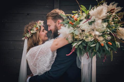 Wedding Couple and large flowers