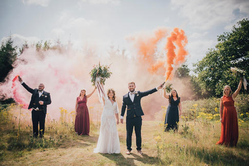 Intimate wedding party and smoke bombs